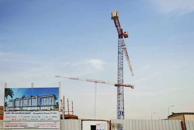 Two Raimondi MRT111 topless tower cranes put to work at new upscale development in Muscat