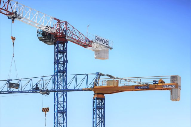 Two Raimondi topless tower cranes at work in historic district of Florence, Italy