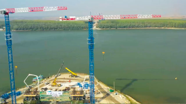 Raimondi MRT294 flat top tower cranes participate in the build of suspension bridge in Romania